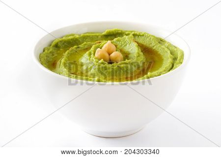 Avocado hummus in bowl isolated on white background