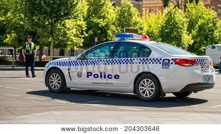 Adelaide Australia - November 14 2015: South Australian police car closed the street in Adelaide's CBD with the policeman patrolling on the background