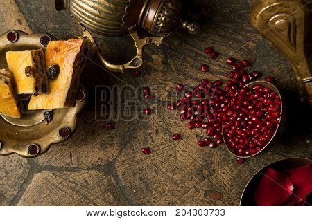 Grains Of Pomegranate On Old Paving Stones