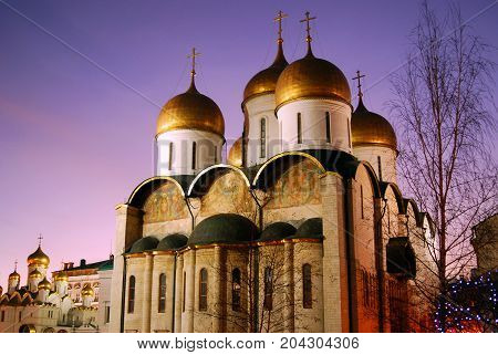 Dormition church of Moscow Kremlin. UNESCO World Heritage Site. Color photo. Blue evening sky background.