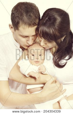 Family Kiss Newborn Baby Mother and Father Kissing New Born Child Kid One Month Old
