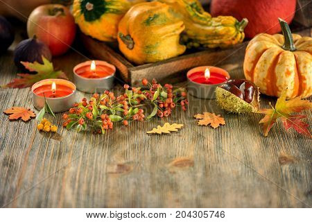 Autumn table setting with pumpkings and candles fall home decoration for festive dinner