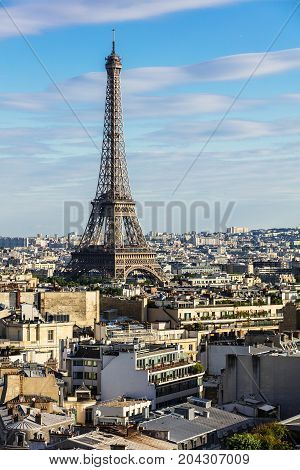 Paris cityscape with Eiffel Tower from the top of Arc de Triomphe de l'Etoile at the summer sunset. Paris France
