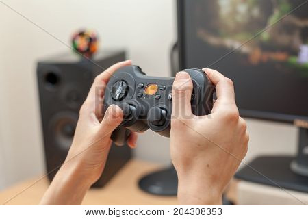 Playing video game with new gamepad close-up.