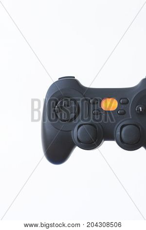 Close-up of a black gamepad on a white background