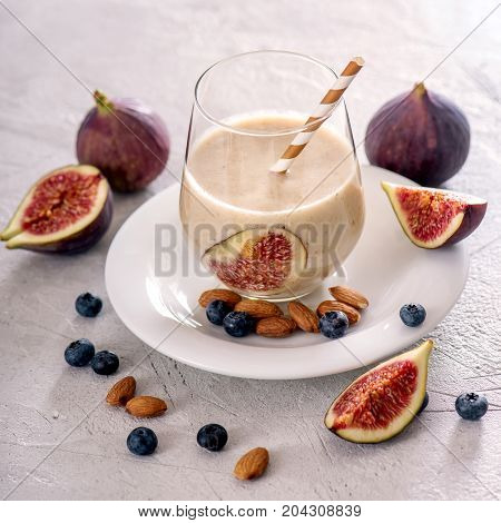 Healthy smoothie with figs and nuts vegan autumn drink with almond milk energy shake