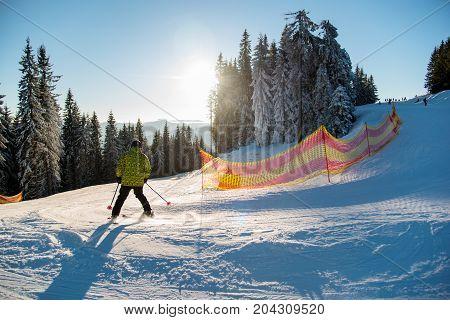 Skier Riding On Fresh Snow Go Down The Ski Resort In The Carpathian Mountains At Sunny Day. Bukovel