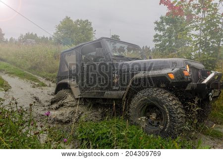 10.09.2017. Leningrad region. Russia. Jeep Wrangler with forest road in the Leningrad region. Wrangler is a compact SUV manufactured by Chrysler