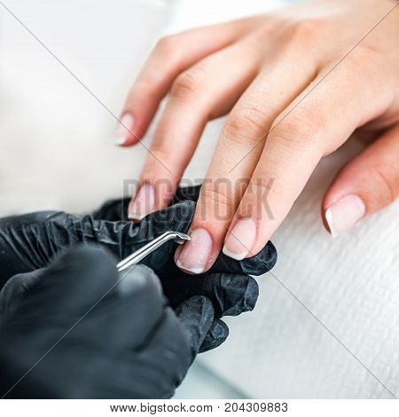Manicuring Nails , Manicure Procedure In Beauty Salon, Toned Image