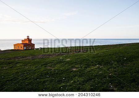 Farm landscape, with the orange house, somewhere in Iceland