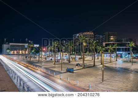 ALBANIA DURRES - September 22 2015: Evening view of the main square of the city Illyrian (sheshi Iliria) the Alexander Moissi Drama Theater (1953) and fountains illuminated by colorful lights