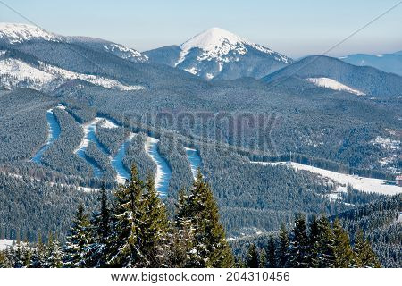View Of Beautiful Snowy Mountains, Forests, Ski Slopes At Ski Resort On A Sunny Winter Day Bukovel L