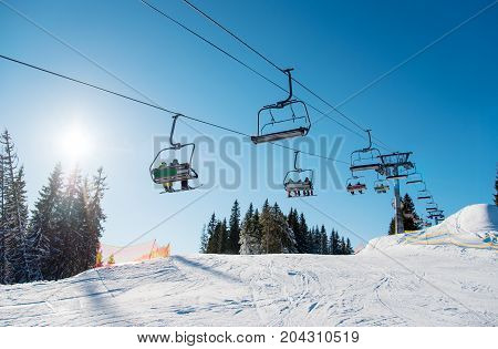 Low Angle Shot Of A Ski Lift At Ski Resort Bukovel In The Mountains On A Sunny Winter Day. Blue Sky,