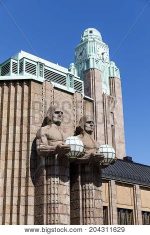 HELSINKI FINLAND - AUGUST 05 2017: Statues on the exterior of the central railway station in Helsinki capital of Finland on August 05 2017