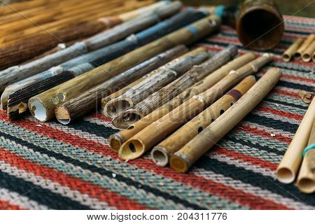 Ethnic woodwind flutes, wooden musical instruments handmade, selective focus