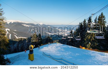 Beautiful Winter Landscape At Ski Resort Copyspace People Riding Ski-lift To The Top Of The Mountain