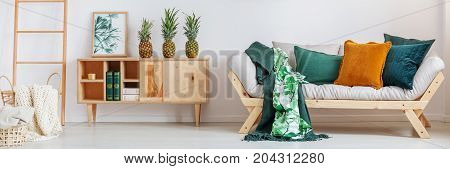 Pineapples On Rustic Cupboard