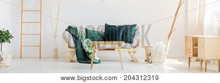 Sofa With Moss Green Pillows
