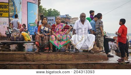 Indian People Sitting On Ganges Riverbank