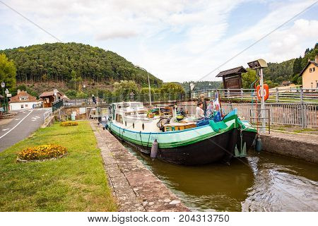 LutzelbourgFrance-September 062017 Boats wait to leave the locks at the river Zorn on the Canal de la Marne au Rhin