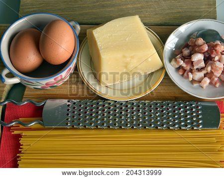 Italian cuisine, ingredients for carbonara spaghetti, still life, part of a series