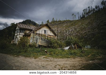 old house in the mountains in the forest