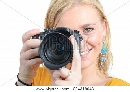 smiling pretty blonde woman photographer with camera on white