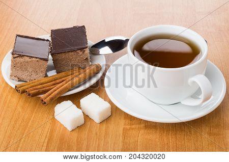 Cakes With Chocolate, Cinnamon In Saucer, Sugar, Tea And Teaspoon