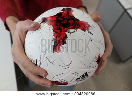 September 14 2017. Moscow Russia A young man holding the Official ball of the 2018 FIFA World Cup Adidas Krasava