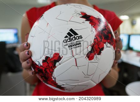 September 14 2017. Moscow Russia A young girl holding the Official ball of the 2018 FIFA World Cup Adidas Krasava