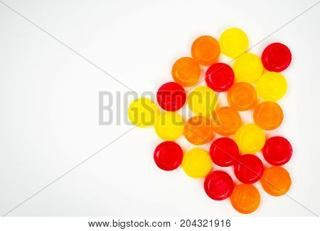 Medical lozenges for relief cough sore throat and throat irritation on white background with copy space