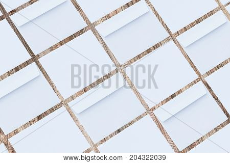 Blank white envelopes on wooden background, two sides. Template for your design. Mockup