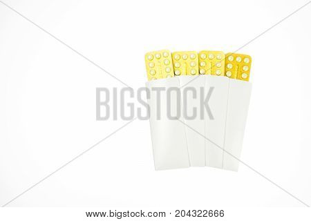 Four blister of contraceptive pills in white envelope isolated on white background with copy space. Family planning concept.