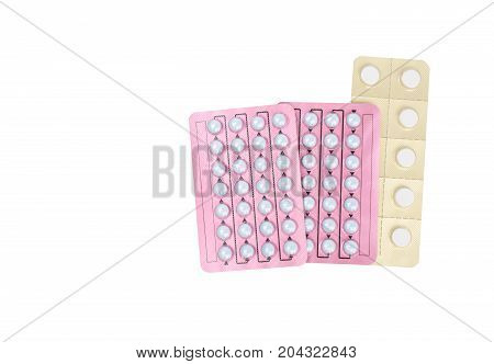 Hormone pills for treatment menopausal woman on white background with copy space. Hormone replacement therapy concept.