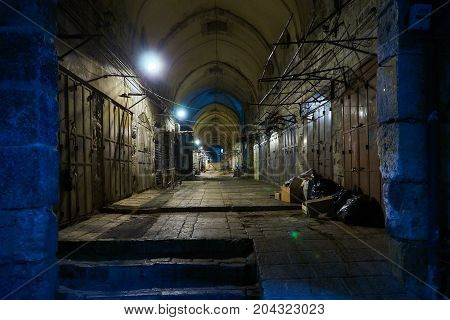 The well known Old City Market (Arab Suoq) at night looses its colors and magic and appears as an ordinary place.