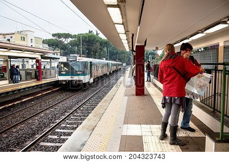 Rome Italy - October 31 2012: Passengers wait on the platform as a trains arrives. Rome Metro has annual ridership of 331 million.