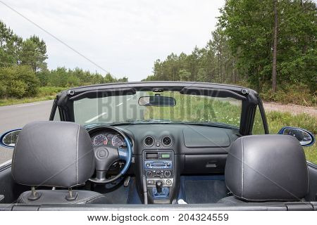 Interior Of Luxury Convertible Car In Road