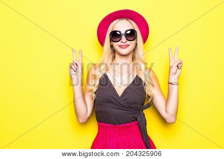 Shouting Young Woman In Elegant Striped Dress Winking And Showing Two Finger Or Peace Sign.