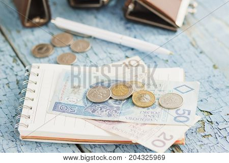 Polish Zloty On The Wooden Background