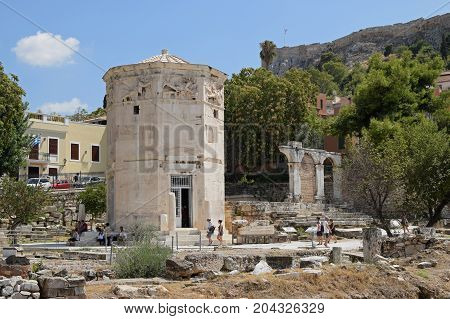 ATHENS GREECE - AUGUST 4 2016: People visiting tower of the winds. Ancient agora of Athens Greece.
