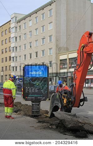 Tampere, Finland - April 8, 2017: man in excavator is digging the ground in Tampere, Finland