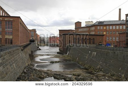 View of old industrial buildings next to the Tammerkoski rapids in Tampere, Finland