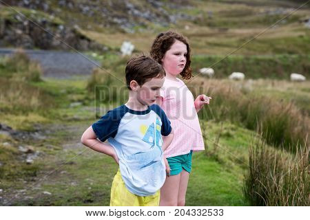 View of Boy and girl walking up the Slieve League Cliffs, County Donegal, Ireland