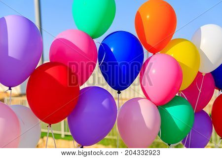 A Many colored balloons at sky background