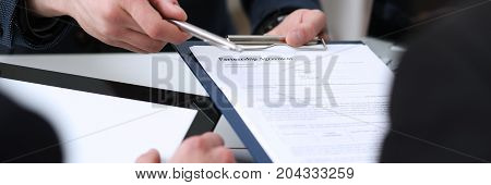 Handsome Man In Suit Offer Contract Form On Clipboard Pad