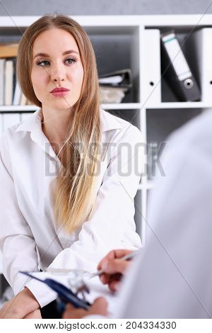 Concerned Female Visitor Portrait Talk With Doctor