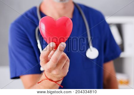 Male Doctor Hold In Arms Red Heart