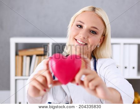 Beautiful Smiling Doctor Hold In Arms Red Heart