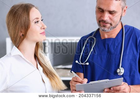 Smiling Handsome Doctor Communicate With Patient