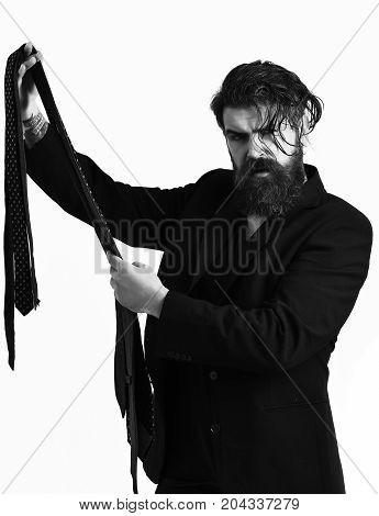Brutal Caucasian Hipster In Black Suit Holding Ties
